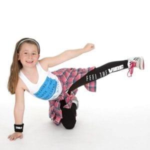 Little girl in dance pose.